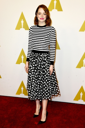 Dots and stripes? Yes you can! Emma proves it with this Michael Kors striped sequins jersey and dots skirt at the Nominees Luncheon in 2015.