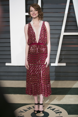 A very chic Altuzarra dress really appropriate for the Vanity Fair Oscars Party in 2015.