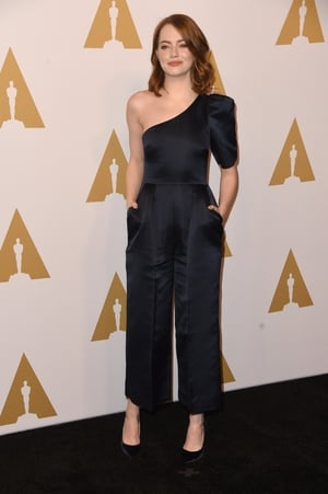 Emma in a one-should satin Stella McCartney jumpsuit at this year's Oscar Nominee Luncheon. She just looks so cool with this graphic shape and wide legs pants.
