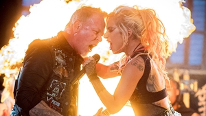 Metallica frontman James Hetfield sharing Lady Gaga's mic after his own failed