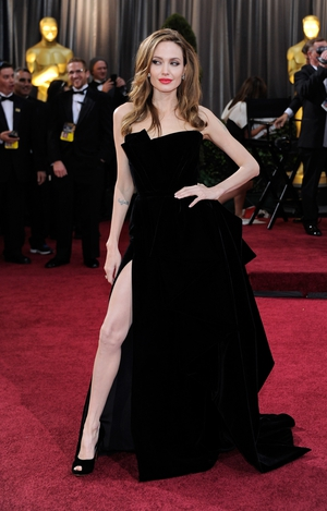 The actress in a Versace gown showing off that leg at the 2012 Oscars ceremony.