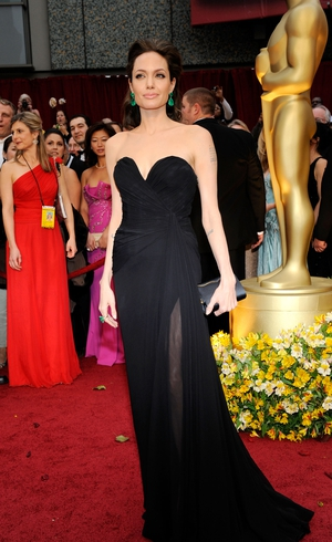 Rocking a gorgeous Elie Saab bustier gown at the 2009 awards. She was nominated for Best Actress for 'Changeling'. We love those green statement earrings!