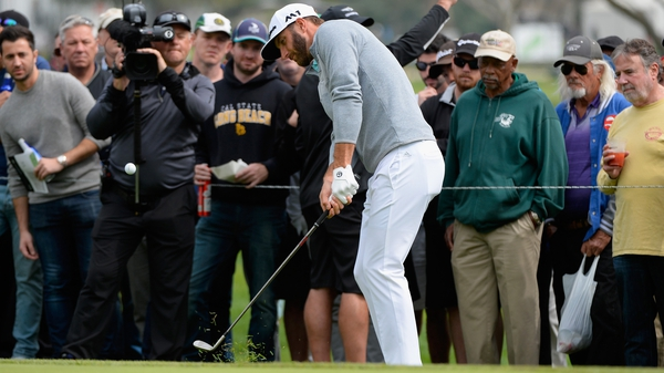 Dustin Johnson chips onto the fourth green during the first round at the Genesis Open