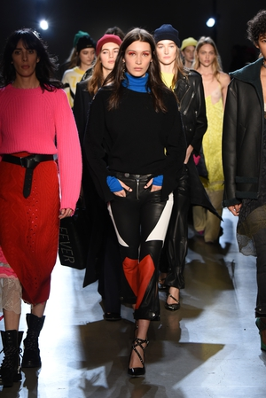 February 13th Day 5: Bella Hadid stands out from the crowd with red make-up and leather pants at the Zadig & Voltaire show.