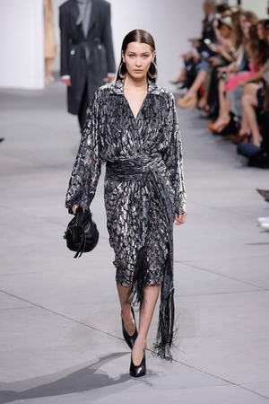February 15th Day 7: Bella Hadid was everywhere! She walked in Michael Kors fashion show, wearing big earrings and velvet fringed dress. Never too much for Bella!