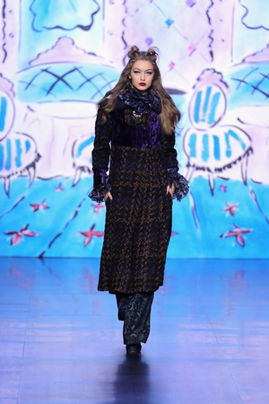 February 15th Day 7: Older Sister Gigi Hadid on the catwalk at the Anna Sui fashion show.