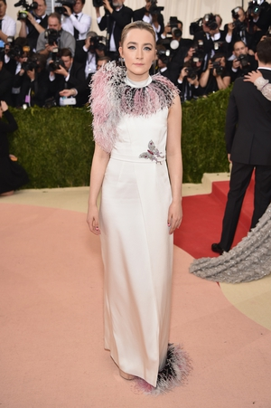 Saoirse Ronan wore a Giuseppe feathered dress to the 2016 Met Gala. Theme: Manus x Machina: Fashion in an Age of Technology