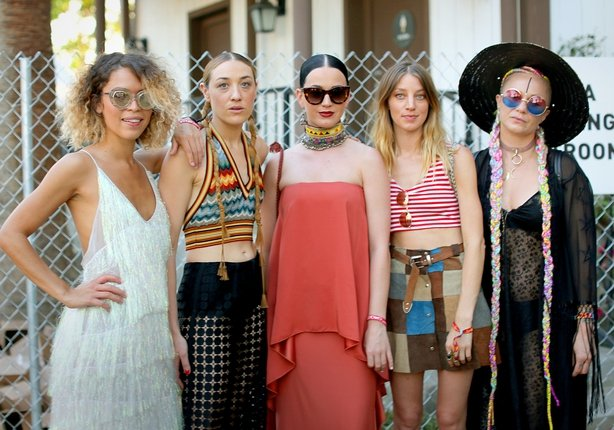 Mia Moretti (2ndL) and Katy Perry (C) with guests in the VIP arena during the 2015 Coachella Valley
