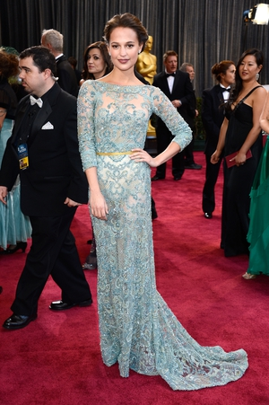 Alicia looks simply stunning in this blue sequin embroidered Elie Saab gown at the ceremony in 2013.
