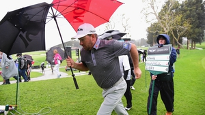 Graeme McDowell posted a one-under-par round before play was suspended