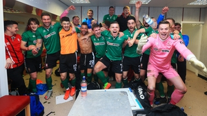 The Lincoln City team celebrate their win