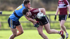 St Mary's Ciaran Mac Iomhar is tackled by Andy McDonnell of UCD