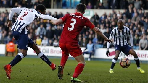 Millwall's Shaun Cummings (L) scores the winner