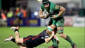 Connacht's Jake Heenan is tackled by Sam Beard of Dragons in Galway