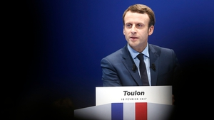 Pro-Europe candidate Emmanuel Macron has accused Moscow of being behind a flurry of cyber attacks on his campaign website