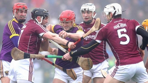 Lee Chin tries to force his way through three Galway players