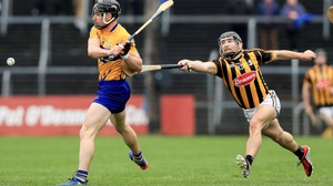 Clare's Seadna Morey is tackled by Richie Hogan of Kilkenny