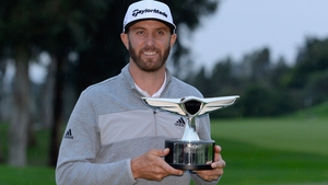 Dustin Johnson poses with the Genesis Open trophy