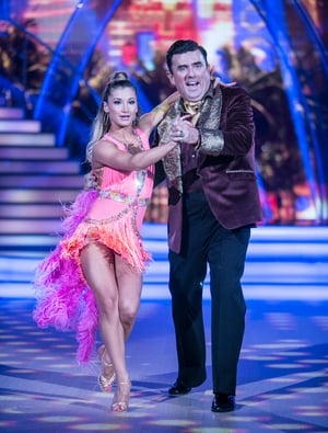 Week 7: Dancing Dessie rocked a burgundy and gold jacket for his Samba with Ksenia who looked fabulous in fluorescent pink, purple and orange.