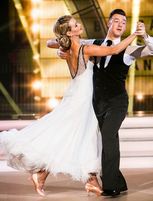 Week 7: Aoibhín looks like a 1920's screen siren. The hair, make up and backless white gown with feather detail has blown us away. Her foxtrot with Kai was stunning!