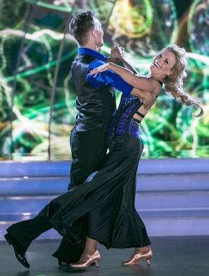 Week 7: The Viennese Waltz certainly brought a smile to Denise's face. We love the strap detailing on her backless blue gown.
