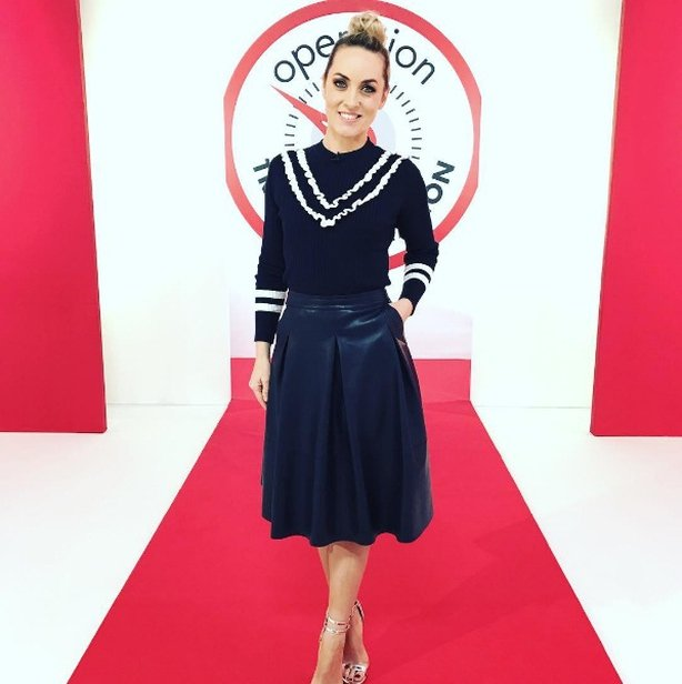 6863080614ac7 Kathryn looks modern and chic with this simple black jumper with white  frills and a cool navy leather skirt from Dunnes Stores! Love this look?