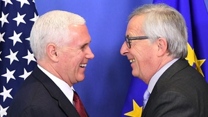 US Vice-President Mike Pence (L) is welcomed by European Commission President Jean-Claude Juncker at the European Commission