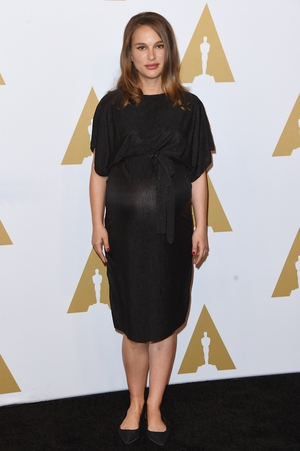 Keeping it simple and comfy in a Topshop Maternity dress at the latest Oscars Nominee Luncheon. The actress is nominated for her role in 'Jackie'.