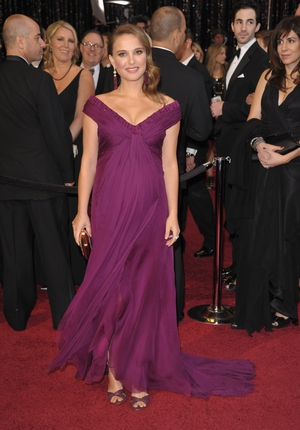 The iconic purple Rodarte gown Natalie wore and she picked up her Oscar for 'Black Swan' in 2011. Maternity suits her so well.