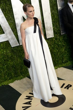 Another immaculate Dior gown with gorgeous black bow enhanced by emerald earrings at the 2013 Vanity Fair Oscar Party.