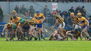 Kilkenny and Clare players battle for possession
