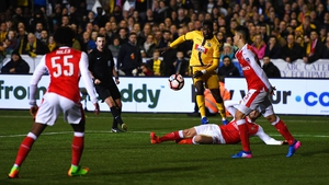 Sutton's Bedsente Gomis shoots at goal