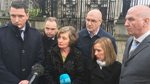 The family of Pat Finucane and solicitor Peter Madden (second left) outside the Royal Courts of Justice in Belfast