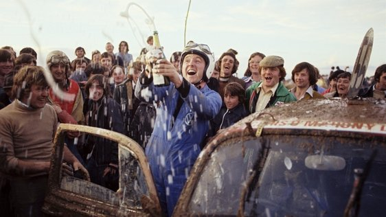 Mike Murphy celebrates with members of Ballinhassig Hot Rod Racing Club (1977)
