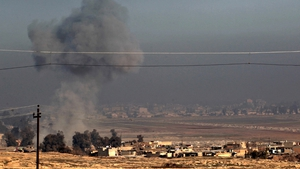 Smoke billows near the village of al-Buseif, south of Mosul, during an offensive by Iraqi forces to retake the western side of the city from IS fighters on 21 February