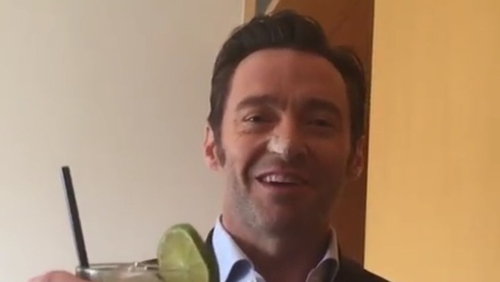 Hugh Jackman raises a glass after his recent treatment for skin cancer
