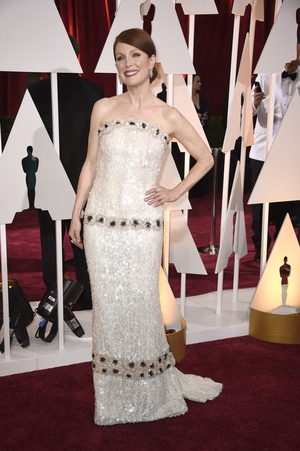 Shimmering in a white sequined bustier Chanel Haute Couture gown in 2015 while accepting her Oscar for 'Still Alice'.