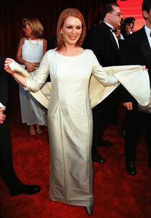 Julianne's very first Oscars red carpet in 1998! The Boogie Nights actress wore a full-length cream and shawl.