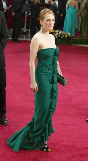 In an Yves Saint Laurent green gown that enhances her red hair and porcelain skin in 2003. Julianne was nominated for her roles in 'Far from Heaven' and 'The Hours'.