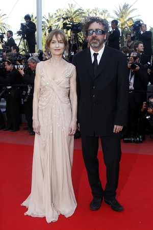 Wearing a romantic off-white dress while posing with director Tim Burton at the 2010 Festival de Cannes.