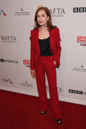 The actress knows how to rock a suit. She looks radiant in red at the BAFTA Tea Party this year.