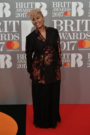 Emeli Sande wore an over-sized coat with pink foil print.