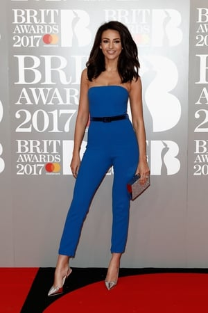 Michelle Keegan worked a cobalt blue jumpsuit with silver heels.