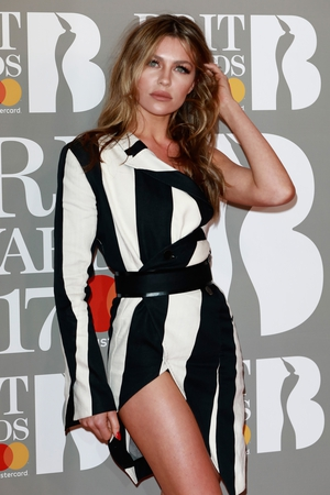 Abbey Clancy in black and white stripes and asymmetrical styling.