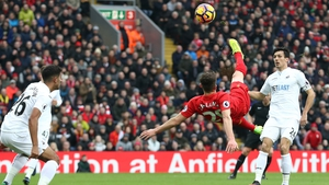 Adam Lallana attempts an overhead against Swansea