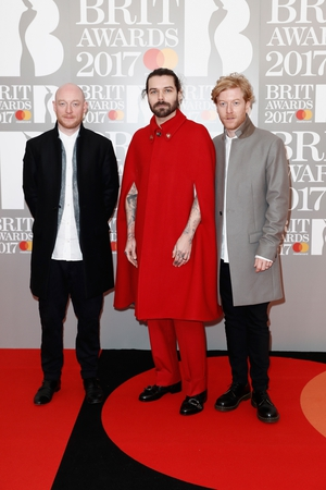 Ben Johnston, Simon Neil and James Johnston of Biffy Clyro. That red cape is certainly eye catching...