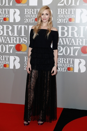 Fearne Cotton in a bardot style black dress with lace detailing.