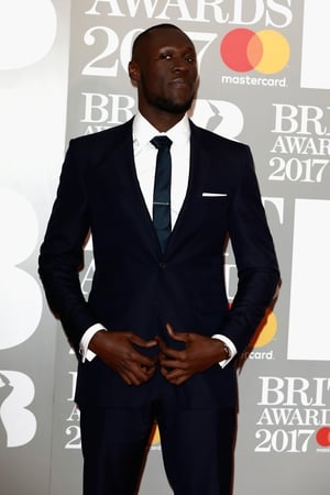 Stormzy looking super classy and a suit and tie before killing it on stage with Ed Sheeran!
