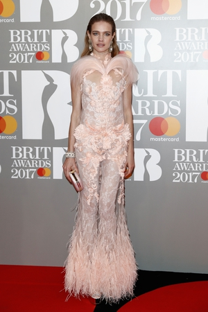 Chic model Natalia Vodianova in a pink feathered gown.