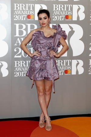 British singer Charli XCX took a risk with this purple off-the-shoulder mini dress!
